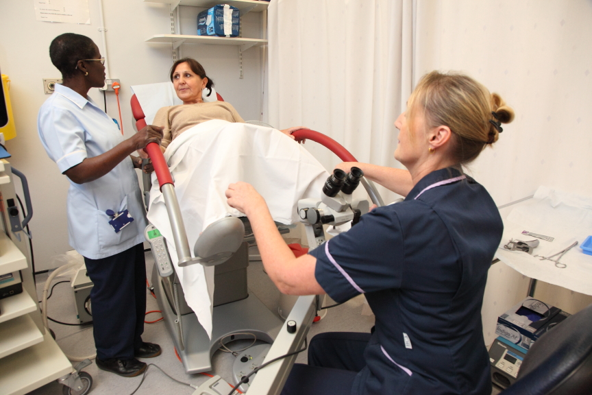 Colposcopy clinic with women on a bed